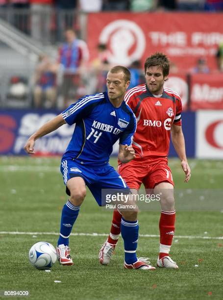 Toronto FC defender Jim Brennan fights for the ball with Kansas City Wizards midfielder Jack Jewsbury during their game on April 26 2008 at BMO Field...