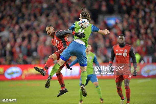 Toronto FC Defender Justin Morrow is tackled by Gustav Svensson during the MLS Cup Final played between the Seattle Sounders and Toronto FC December...
