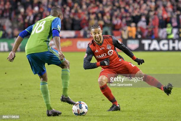 Toronto FC Defender Justin Morrow try's to get past Seattle Sounders defender Kelvin Leerdam during the MLS Cup Final played between the Seattle...