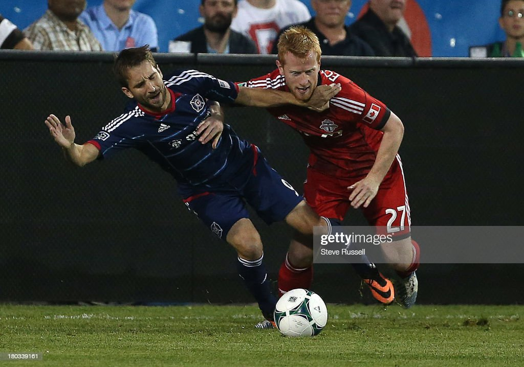 TORONTO ON SEPTEMBER 11 Toronto FC defender Richard Eckersley tries to get past Chicago Fire forward Mike Magee in first half action as Toronto FC...