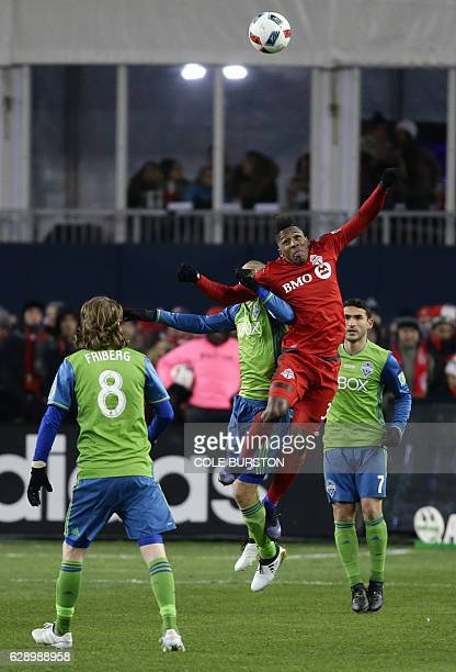 Toronto FC forward Armando Cooper fights for a header with Seattle Sounders midfielder Osvaldo Alonso during the MLS Cup at BMO Field on December 10...