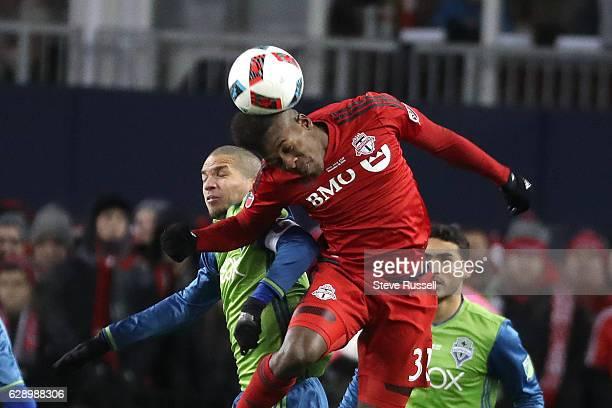 TORONTO ON DECEMBER 10 Toronto FC forward Armando Cooper flies through the air to head the ball against Seattle Sounders midfielder Osvaldo Alonso as...