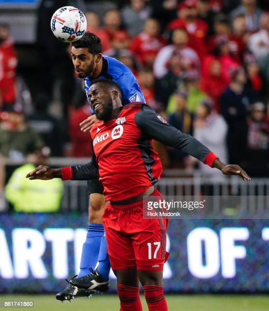 Toronto FC forward Jozy Altidore and Montreal Impact defender Victor Cabrera battle for a ball Toronto FC vs Montreal Impact during 2nd half action...