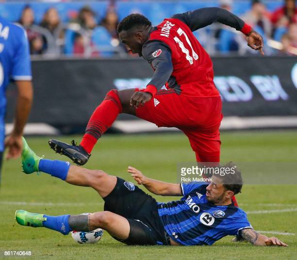 Toronto FC forward Jozy Altidore does some leaping to get past Montreal Impact defender Victor Cabrera Toronto FC vs Montreal Impact during 1st half...