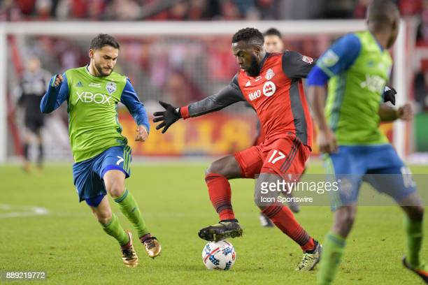 Toronto FC Forward Jozy Altidore is challenged by Seattle Sounders Will Bruin during the first half of the MLS Cup Final played between the Seattle...