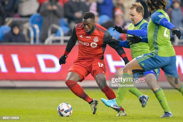 Toronto FC Forward Jozy Altidore is tackled by Seattle Sounders defender Roman Torres during the MLS Cup Final played between the Seattle Sounders...