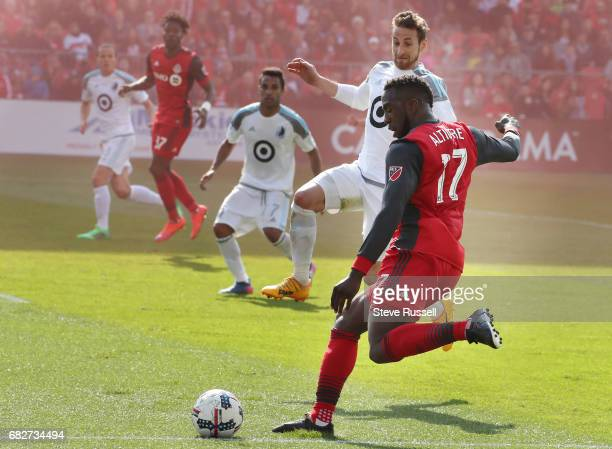 TORONTO MAY 13 Toronto FC forward Jozy Altidore looks to pass to Tosaint Ricketts as Toronto FC beats Minnesota United 32 in MLS action at BMO Field...