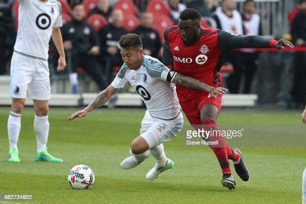 TORONTO MAY 13 Toronto FC forward Jozy Altidore tries to get around Minnesota United defender Francisco Calvo as Toronto FC beats Minnesota United 32...