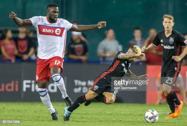 Toronto FC forward Jozy Altidore trips DC United midfielder Luciano Acosta during a MLS match between DC United and Toronto FC on August 05 at RFK...