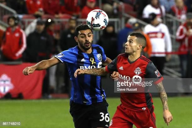 TORONTO ON OCTOBER 15 Toronto FC forward Sebastian Giovinco battles Montreal Impact defender Victor Cabrera as Toronto FC play the Montreal Impact on...