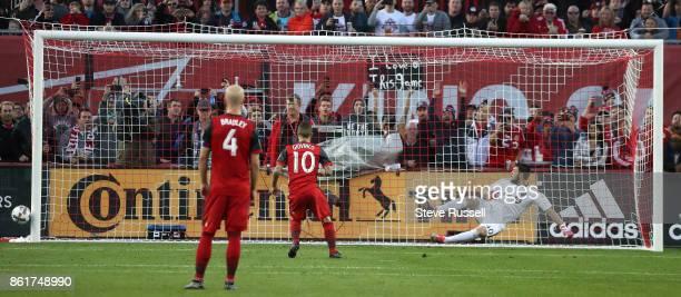 TORONTO ON OCTOBER 15 Toronto FC forward Sebastian Giovinco beats Montreal Impact goalkeeper Maxime Crepeau but not the post on a penalty kick as...