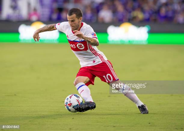 Toronto FC forward Sebastian Giovinco drives towards the goal during the MLS soccer match between the Orlando City SC and Toronto FC on July 5 2017...