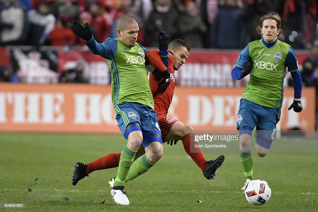 Toronto FC Forward Sebastian Giovinco (10) fights for the ball with Seattle Sounders Defender Osvaldo Alonso (6) during the MLS Cup final game between the Seattle Sounders and Toronto FC on December 10, 2016 at BMO Field in Toronto, ON. Seattle won the MLS Cup in penalty kicks.