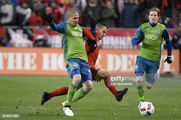 Toronto FC Forward Sebastian Giovinco fights for the ball with Seattle Sounders Defender Osvaldo Alonso during the MLS Cup final game between the...