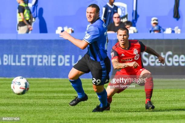 Toronto FC forward Sebastian Giovinco gets rid of the ball in front og Montreal Impact midfielder Samuel Piette during the Toronto FC versus the...