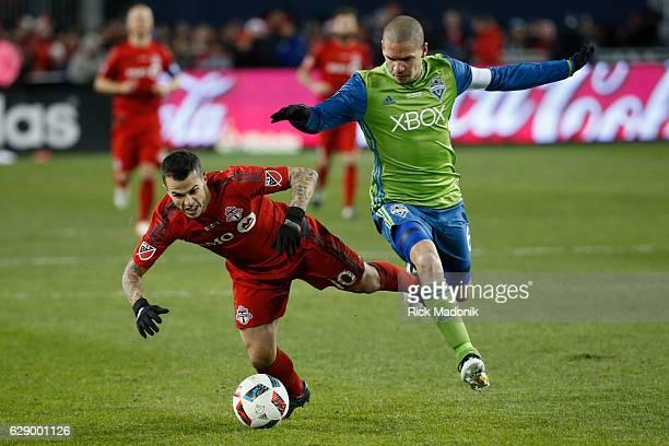 Toronto FC forward Sebastian Giovinco gets tripped up by Seattle Sounders midfielder Osvaldo Alonso Toronto FC vs Seattle Sounders in 2nd half action...
