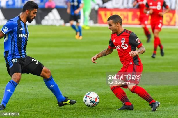 Toronto FC forward Sebastian Giovinco going facing Montreal Impact defender Victor Cabrera during the Toronto FC versus the Montreal Impact game on...