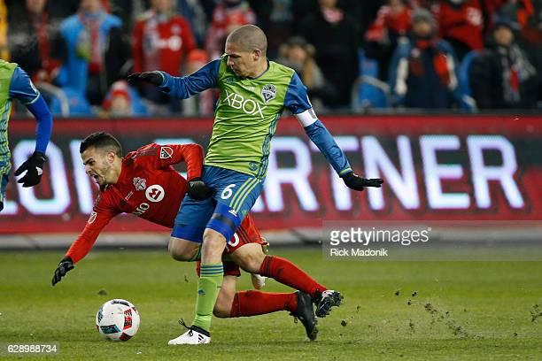 Toronto FC forward Sebastian Giovinco is fouled by Seattle Sounders midfielder Osvaldo Alonso Toronto FC vs Seattle Sounders in 1st half action of...
