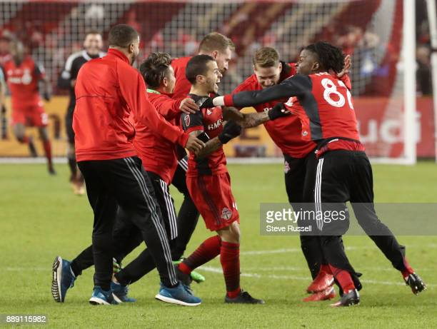 TORONTO ON DECEMBER 9 Toronto FC forward Sebastian Giovinco is surrounded by teammates after the final whistle as the Toronto FC beats the Seattle...