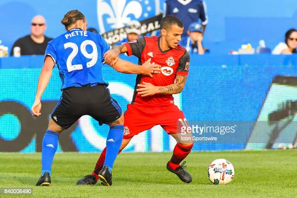 Toronto FC forward Sebastian Giovinco keeping control of the ball in front of Montreal Impact midfielder Samuel Piette during the Toronto FC versus...