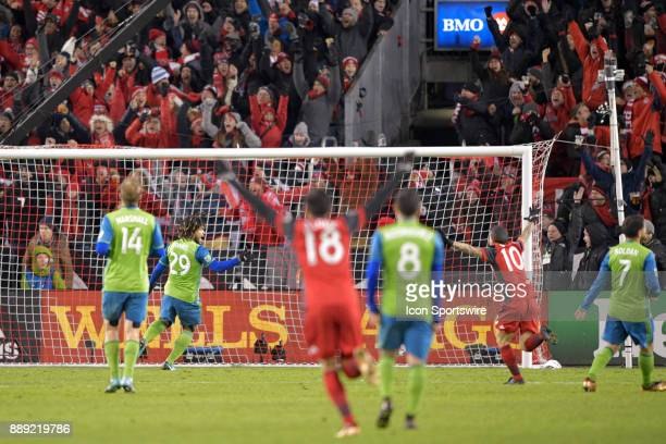 Toronto FC Forward Sebastian Giovinco leads teammate Marco Delgado in celebrating the team's first goal during the MLS Cup Final played between the...