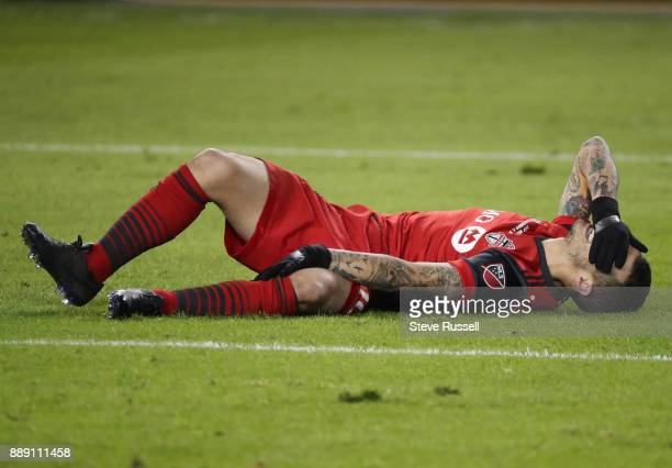 TORONTO ON DECEMBER 9 Toronto FC forward Sebastian Giovinco lies on the ground after getting knocked down as the Toronto FC beats the Seattle...