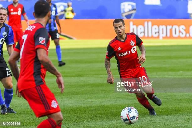 Toronto FC forward Sebastian Giovinco passing the ball to Toronto FC midfielder Victor Vazquez during the Toronto FC versus the Montreal Impact game...