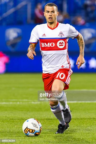 Toronto FC forward Sebastian Giovinco running on the field in control of the ball during the Toronto FC versus the Montreal Impact game on June 21 at...