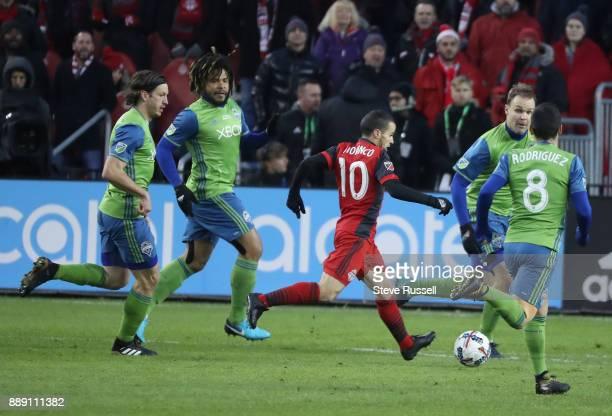 TORONTO ON DECEMBER 9 Toronto FC forward Sebastian Giovinco runs through a quartet of defenders as the Toronto FC beats the Seattle Sounders 20 in...