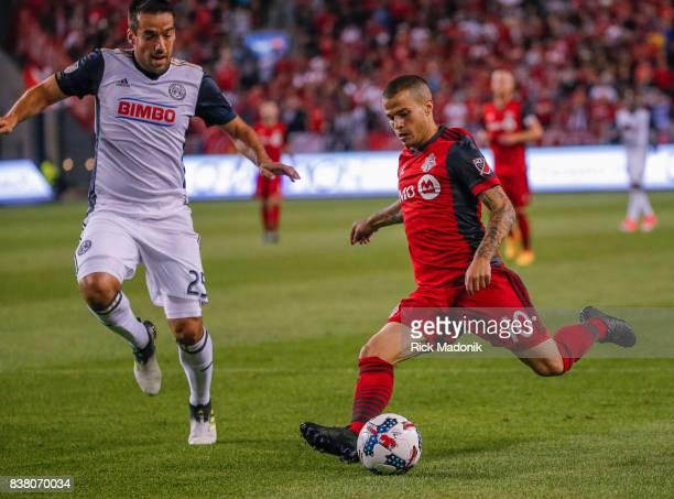 Toronto FC forward Sebastian Giovinco unleashes a shot as Philadelphia Union midfielder Ilsinho tries to intercept Toronto FC vs Philadelphia Union...