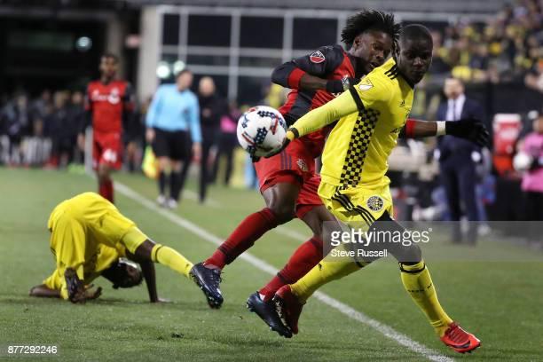 COLUMBUS OH NOVEMBER 21 Toronto FC forward Tosaint Ricketts and Columbus Crew defender Jonathan Mensah chase a ball as the Toronto FC plays the...