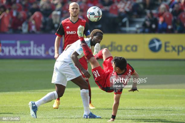 TORONTO MAY 13 Toronto FC midfielder Marco Delgado leaps for a ball over Minnesota United midfielder Kevin Molino as Toronto FC beats Minnesota...