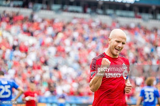 Toronto FC midfielder Michael Bradley celebrates his first half goal during TFC's first half against the Montreal Impact at BMO Field on August 29...