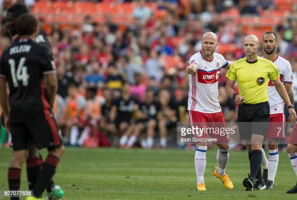 Toronto FC midfielder Michael Bradley complains to referee Allen Chapman during a MLS match between DC United and Toronto FC on August 05 at RFK...