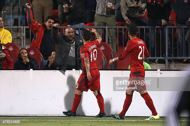 TORONTO ON MAY 13 Toronto FC midfielder Sebastian Giovinco celebrates with fans after scoring as Toronto FC beats the Montreal Impact 32 in the...