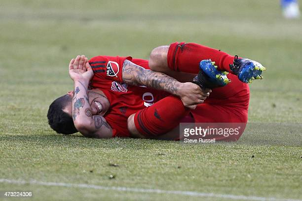 TORONTO ON MAY 13 Toronto FC midfielder Sebastian Giovinco is injured in the first half as Toronto FC beats the Montreal Impact 32 in the SemiFinal...