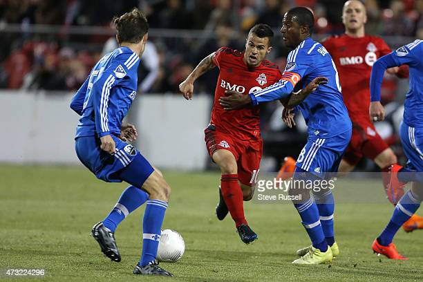 TORONTO ON MAY 13 Toronto FC midfielder Sebastian Giovinco runs through the defence as Toronto FC beats the Montreal Impact 32 in the SemiFinal of...