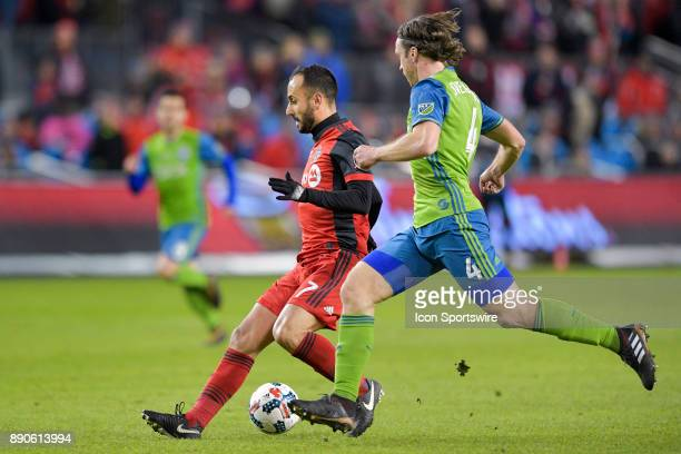 Toronto FC Midfielder Victor Vazquez is pursued by Seattle Sounders Defender Gustav Svensson during the MLS Cup Final played between the Seattle...