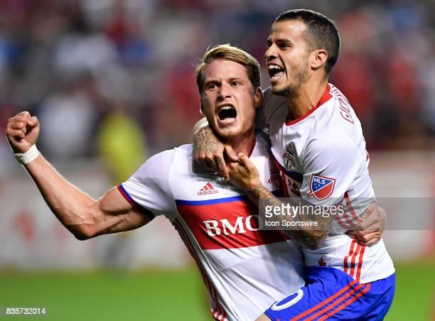 Toronto FC Nicolas Hasler and Toronto FC forward Sebastian Giovinco celebrate after Toronto FC Nicolas Hasler scores a goal during the match between...
