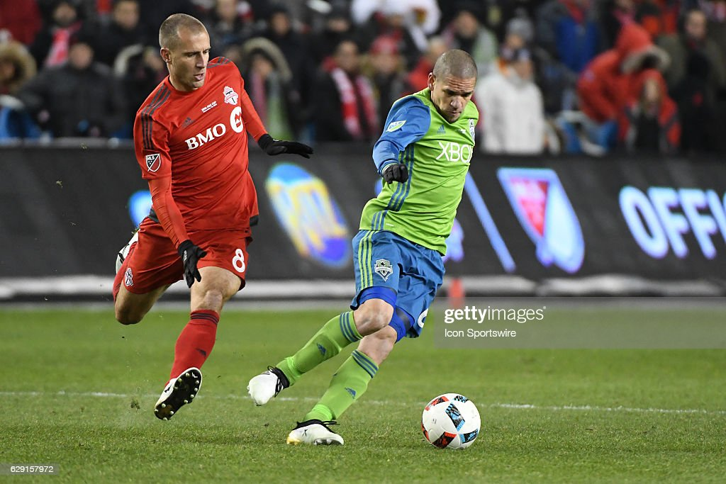 Toronto FC player Benoit Cheyrou (8) chases Seattle Sounders Mid Fielder Osvaldo Alonso (6) during the MLS Cup final game between the Seattle Sounders and Toronto FC on December 10, 2016 at BMO Field in Toronto, ON. Seattle won the MLS Cup in penalty kicks.