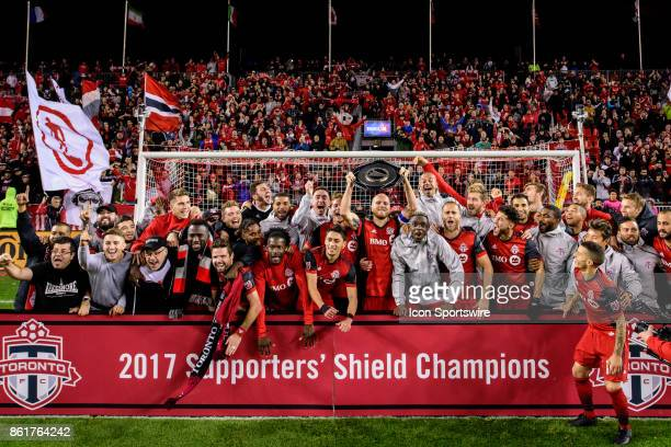 Toronto FC players pose for a team picture with the Supporters' Shield after the MLS Soccer regular season game between Toronto FC and Montreal...
