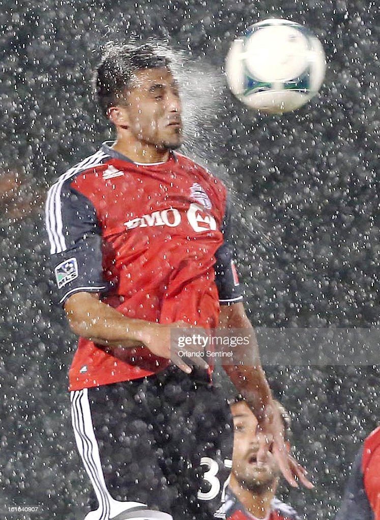 Toronto FC's Andrew Wiedeman leaps to head the ball in the heavy rain against Orlando City Soccer at the Walt Disney World Pro Soccer Classic at the ESPN Wide World of Sports Complex in Orlando, Florida, on Wednesday, February 13, 2013.