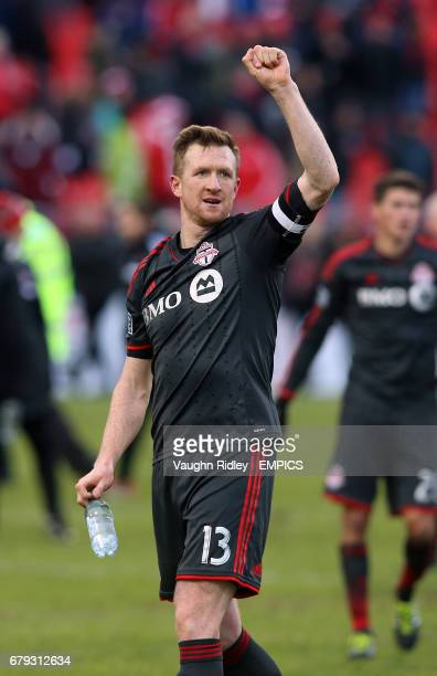 Toronto FC's Captain Steven Caldwell gestures to the crowd following the final whistle