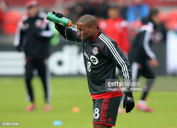Toronto FC's Jemain Defoe cools down during warmup