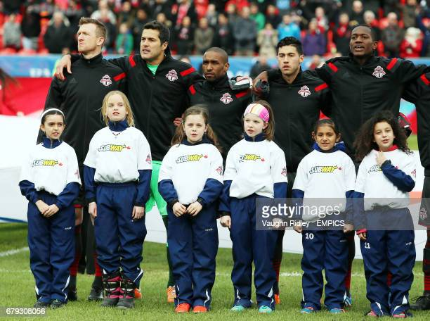 Toronto FC's Jermain Defoe lines up with teammates for the National Anthem