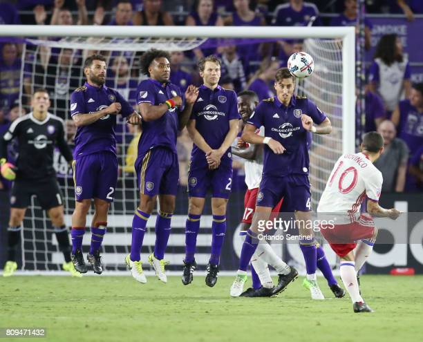 Toronto FC's Sebastian Giovinco scores a goal past an Orlando City wall at Orlando City Stadium on Wednesday July 5 in Orlando Fla Toronto won 31