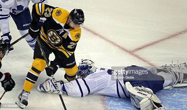 Toronto goalie James Reimer is down and the Bruins Chris Kelly is about to flip the puck over him to put Boston ahead 10 in the first period The...