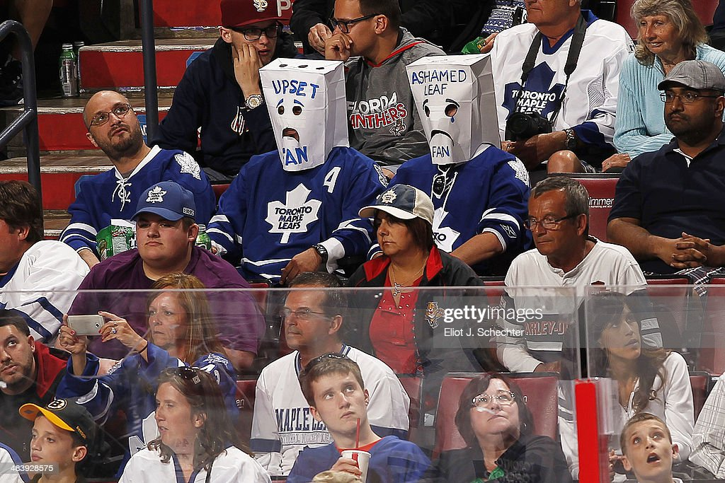 Toronto Maple Leaf fans are upset and ashamed while they take on the Florida Panthers at the BB&T Center on April 10, 2014 in Sunrise, Florida.
