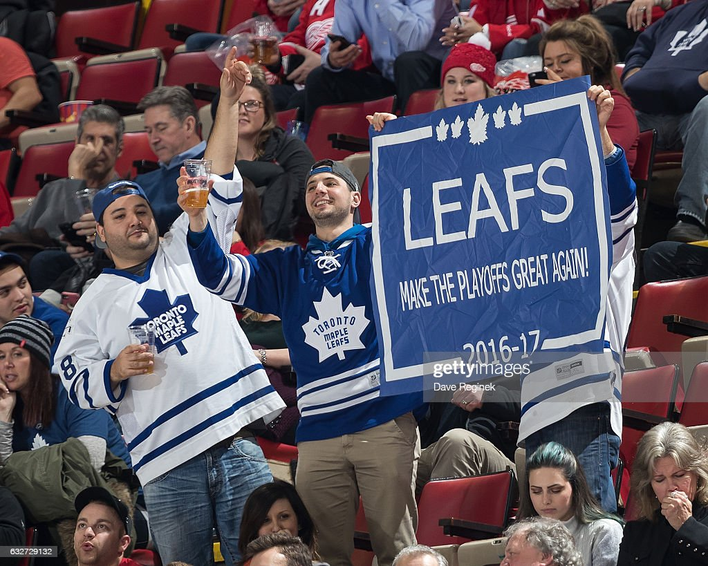 Toronto Maple Leaf fans in the stands wave a sign during an NHL game between the Detroit Red Wings and the Toronto Maple Leafs at Joe Louis Arena on January 25, 2017 in Detroit, Michigan. The Leafs defeated the Wings 4-0.