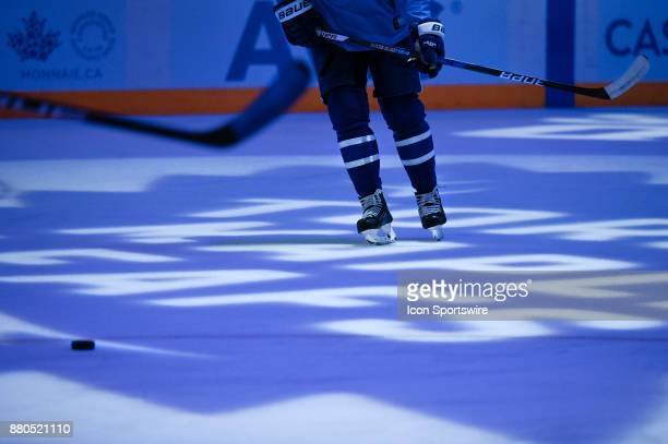Toronto Maple Leaf skates across the team logo illuminated on centre ice before the NHL regular season hockey game between the Washington Capitals...